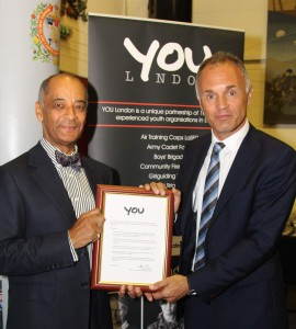 Kenneth Olisa OBE presents YOU London pledge to Dominic Cotton
