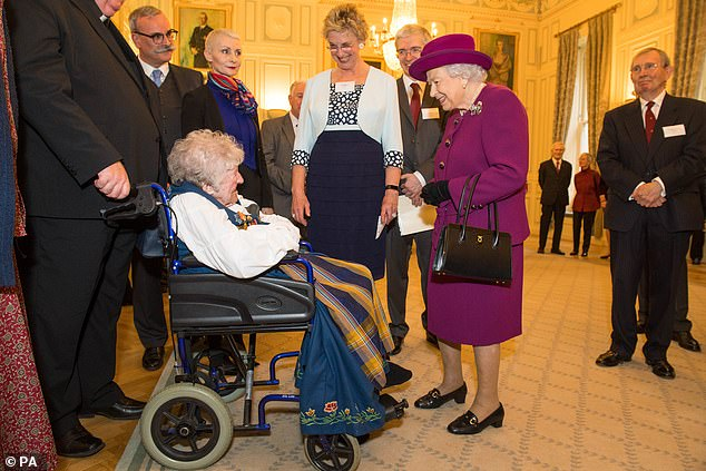 The Queen and The King ofNorway attends a reception at the Naval and Military Club